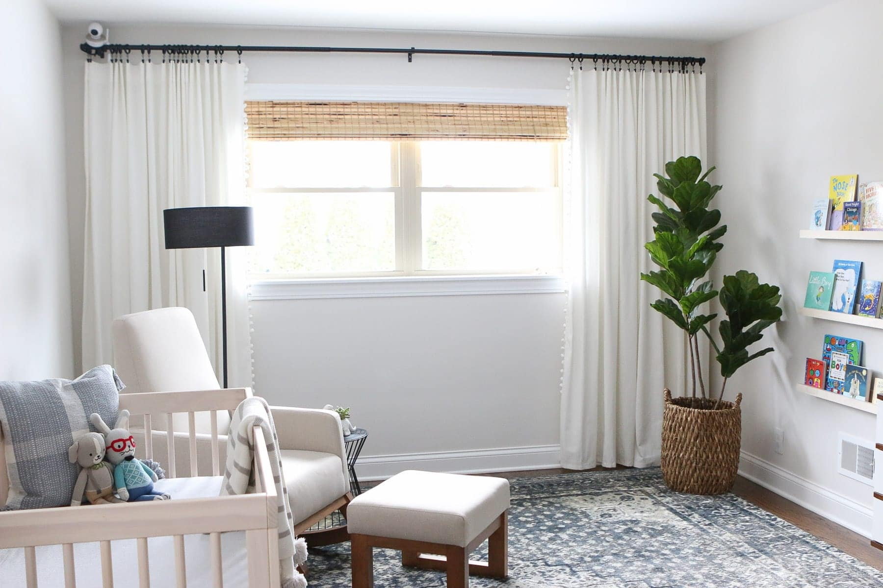 Hanging curtains and furnishing a neutral nursery