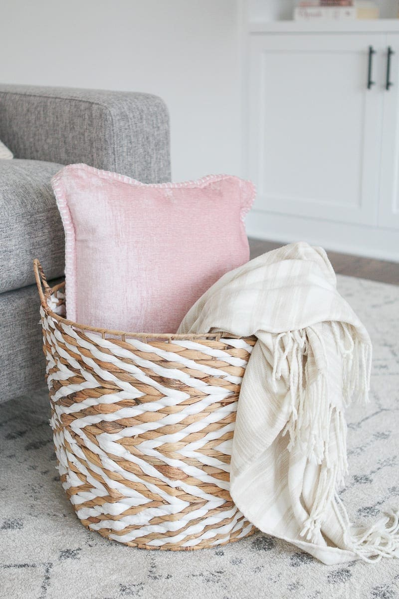 corralling couch clutter with a basket