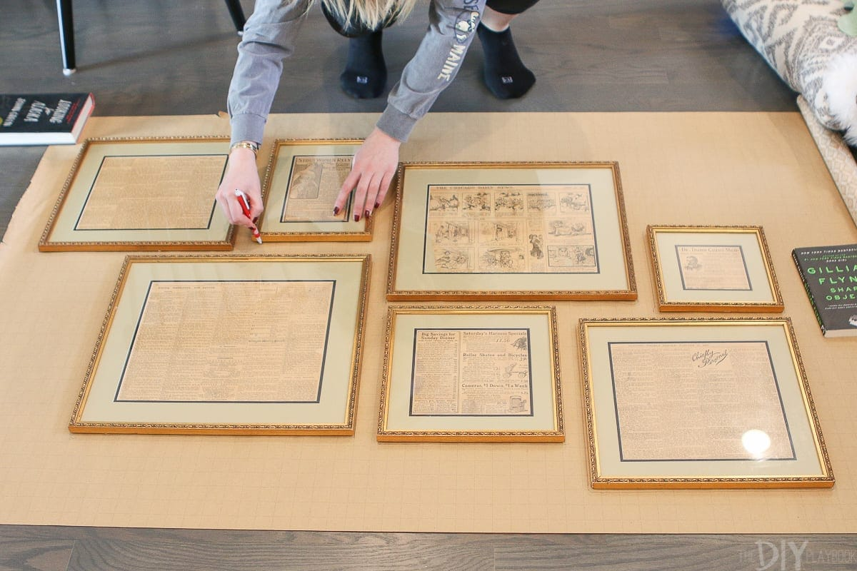 Tracing frames on wrapping paper to create a gallery wall layout.