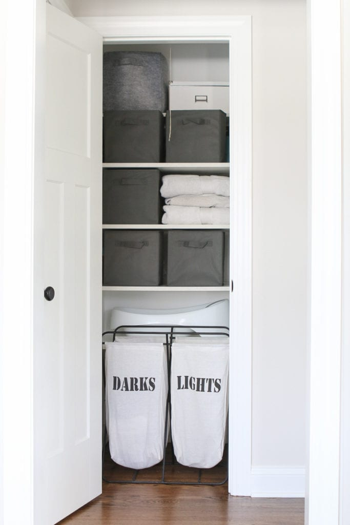 This organized linen closet holds lots of towels and organized laundry