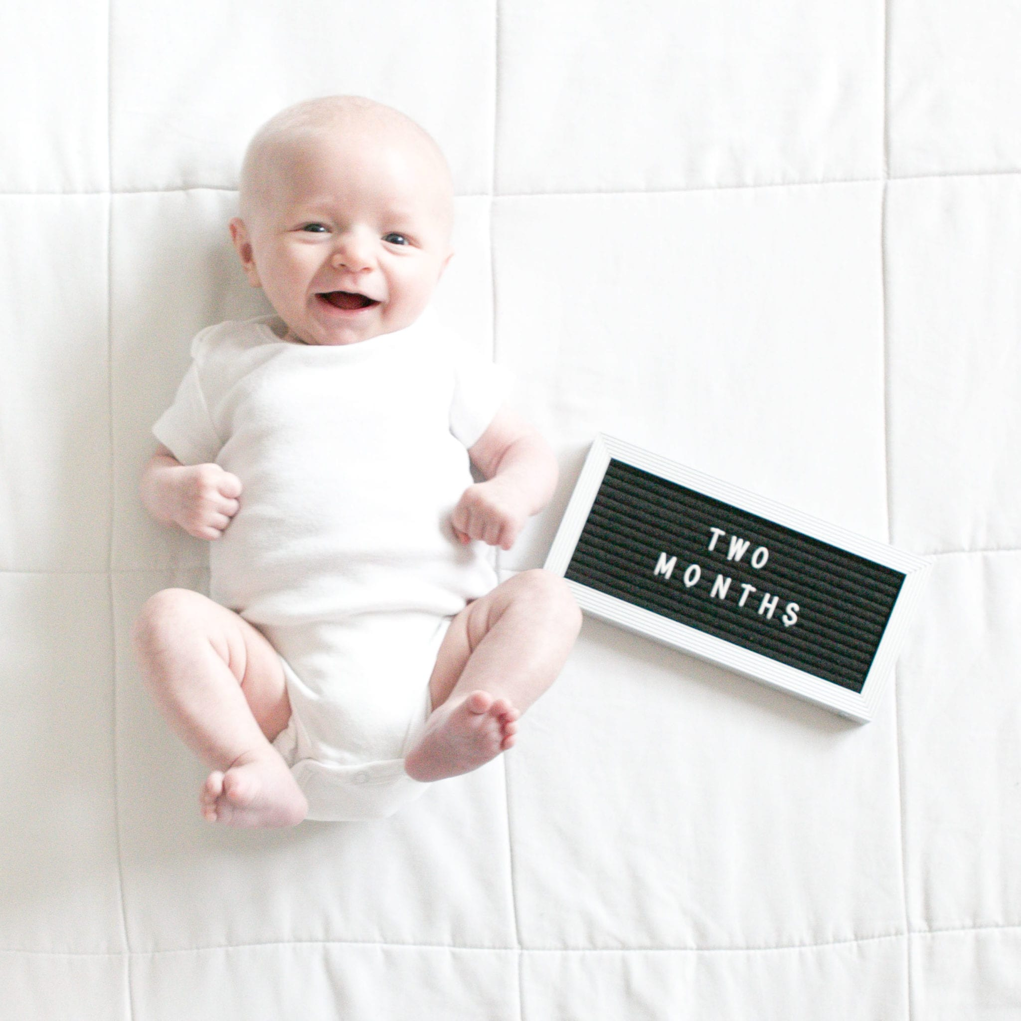 newborn photos with letterfolk board
