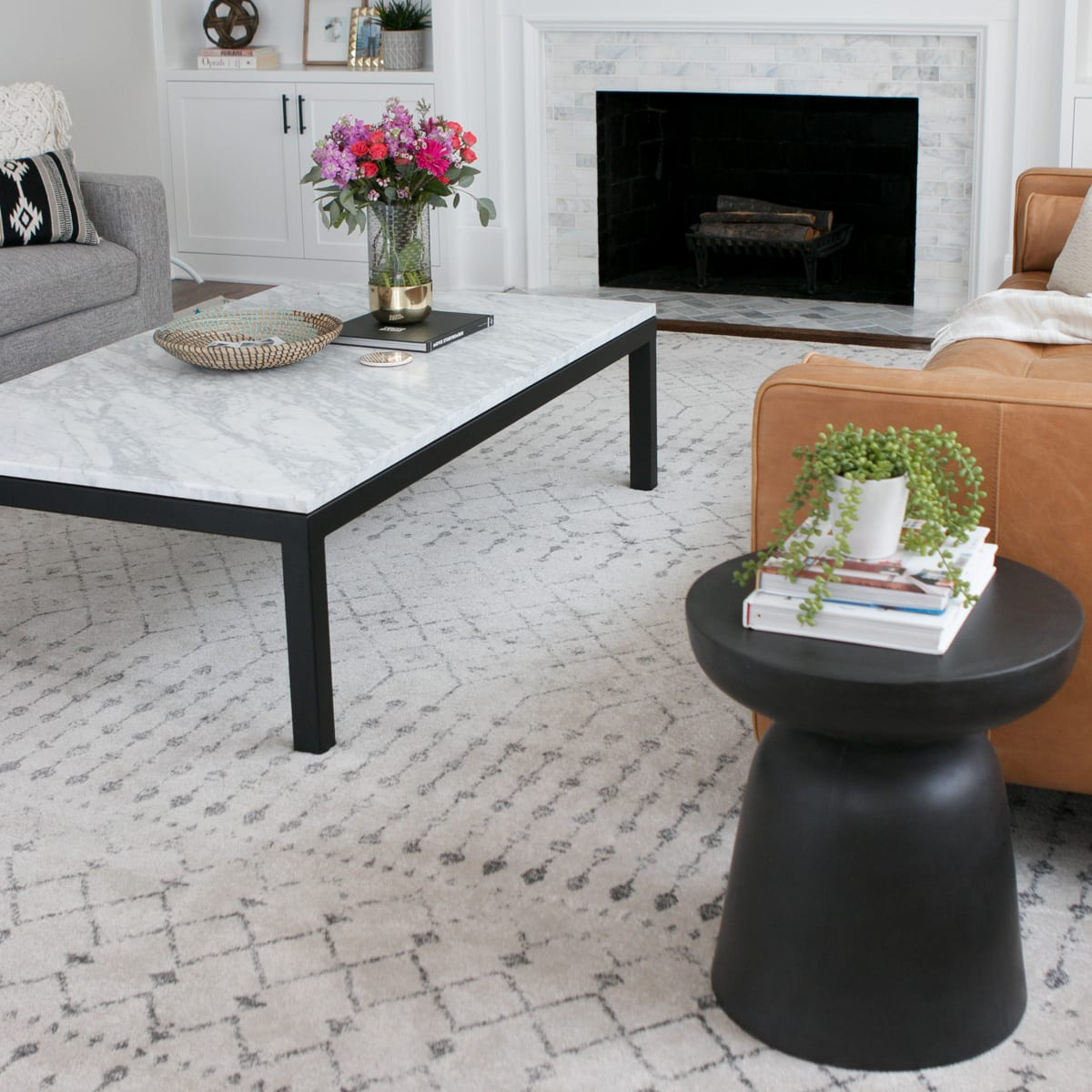 A black side table looks nice with a marble coffee table.