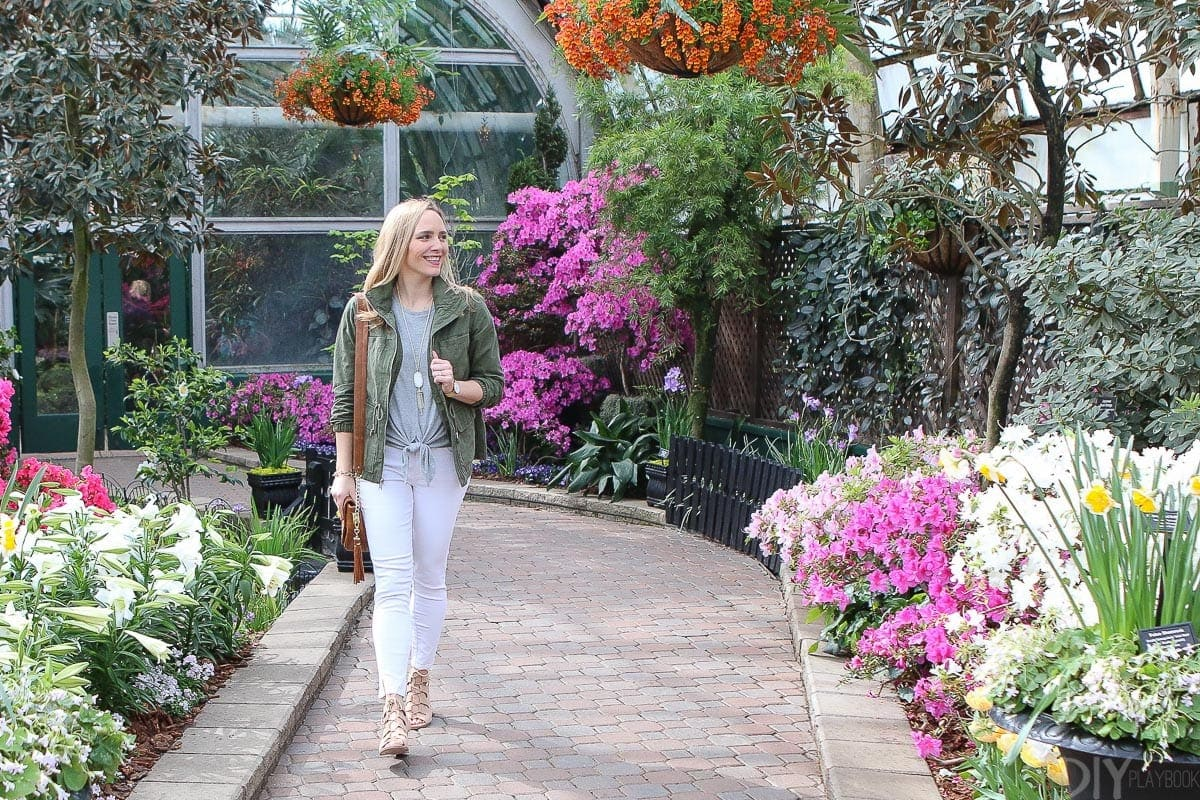 Casey walking through the Lincoln Park conservatory featuring spring clothing