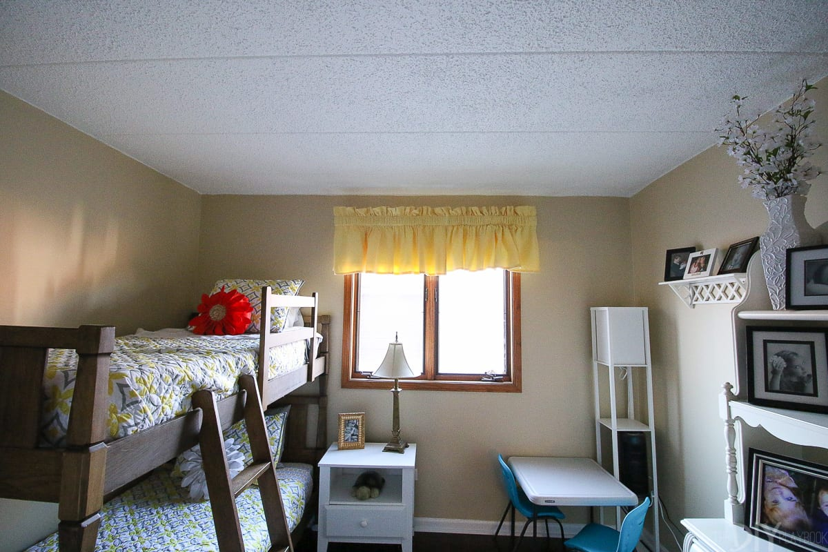 Before pictures of a kids' room makeover with bunk beds and storage