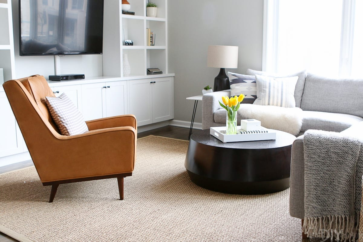 This black coffee table is styled to perfection in this family room.