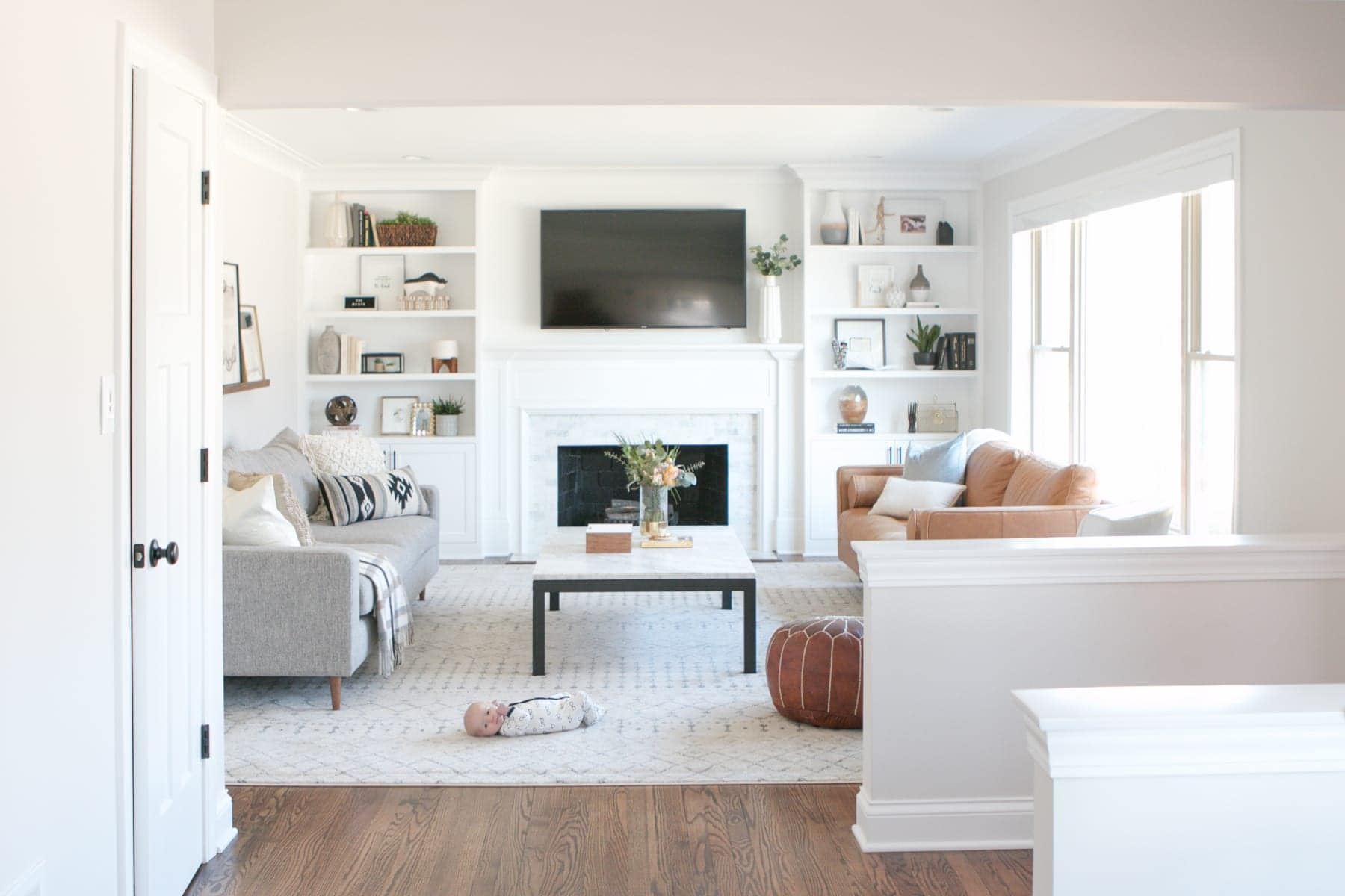 Bright family room space with built ins and 2 couches