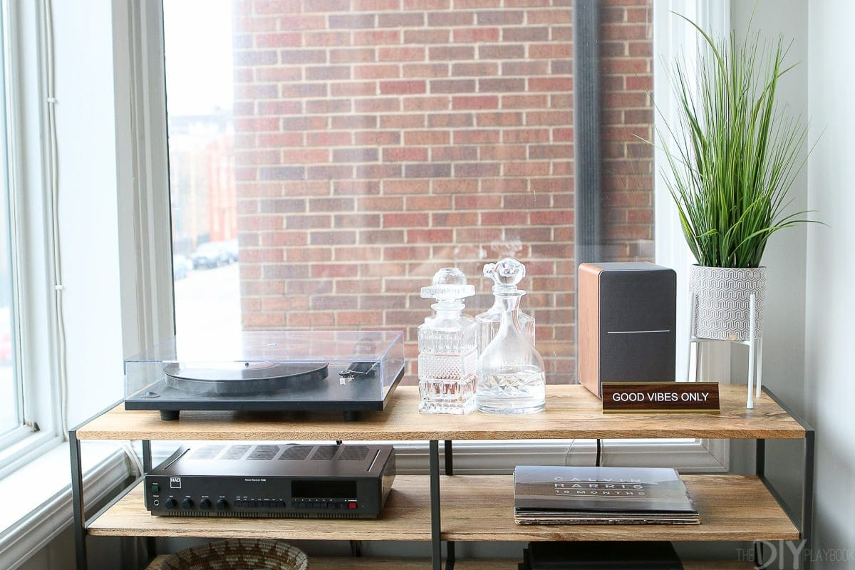 A record console with accessories and a record player