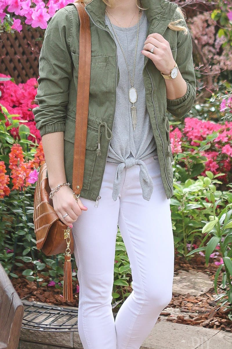 Add a green jacket over a neutral top for a cute spring look