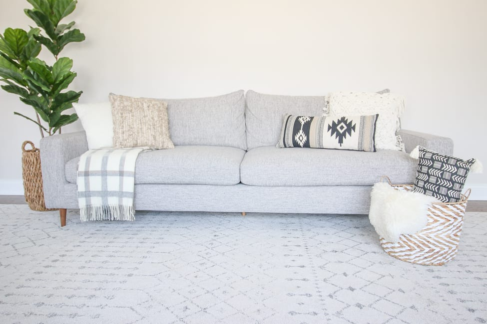 neutral pillows on a couch