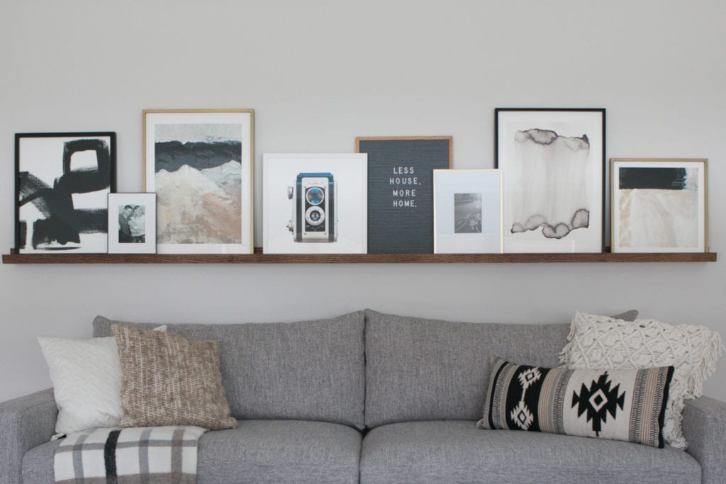 Build a DIY picture ledge for above your couch