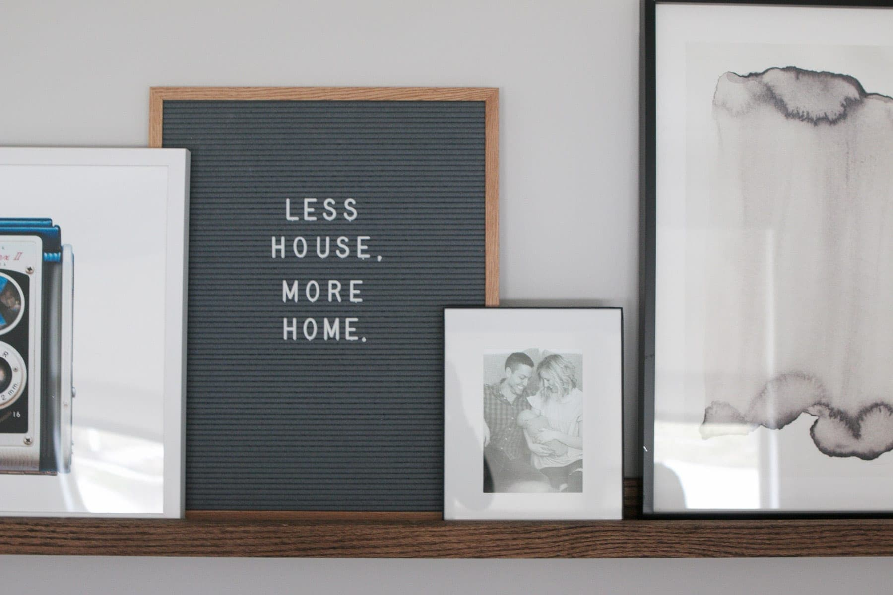 Add a letterfolk board to your picture ledge so you can write fun quotes on there.