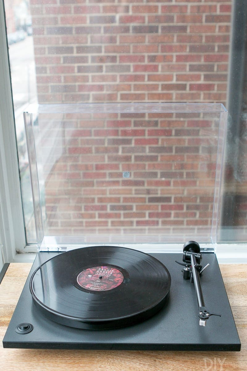 Record player playing Calvin Harris on vinyl.