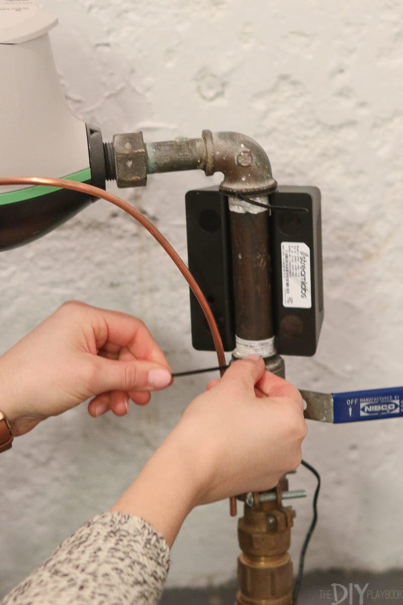Zip tie the smart home water monitor to the main water supply line