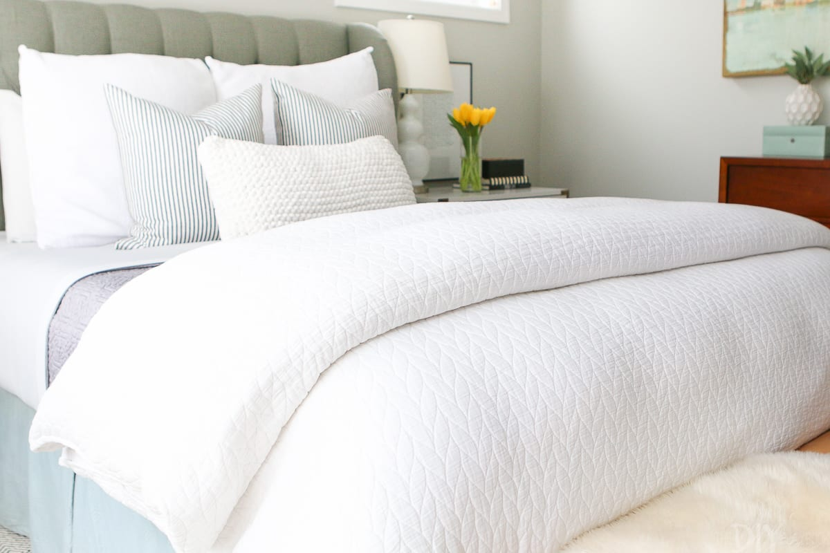 Textured white duvet cover in this master bedroom.