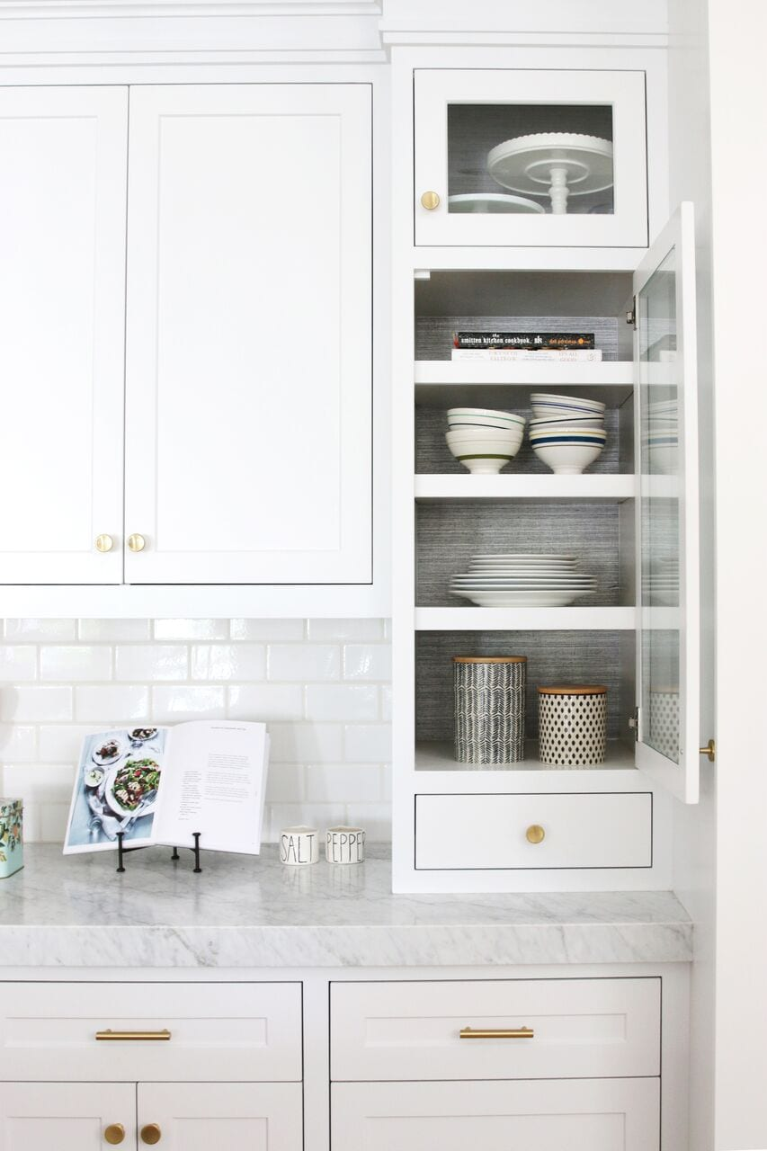 If you're going with a glass kitchen cabinet front, make sure the items inside are styled!