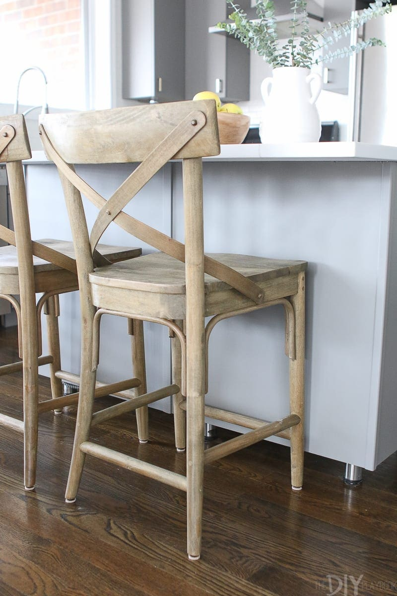 Wood stools from World Market warm up this gray kitchen