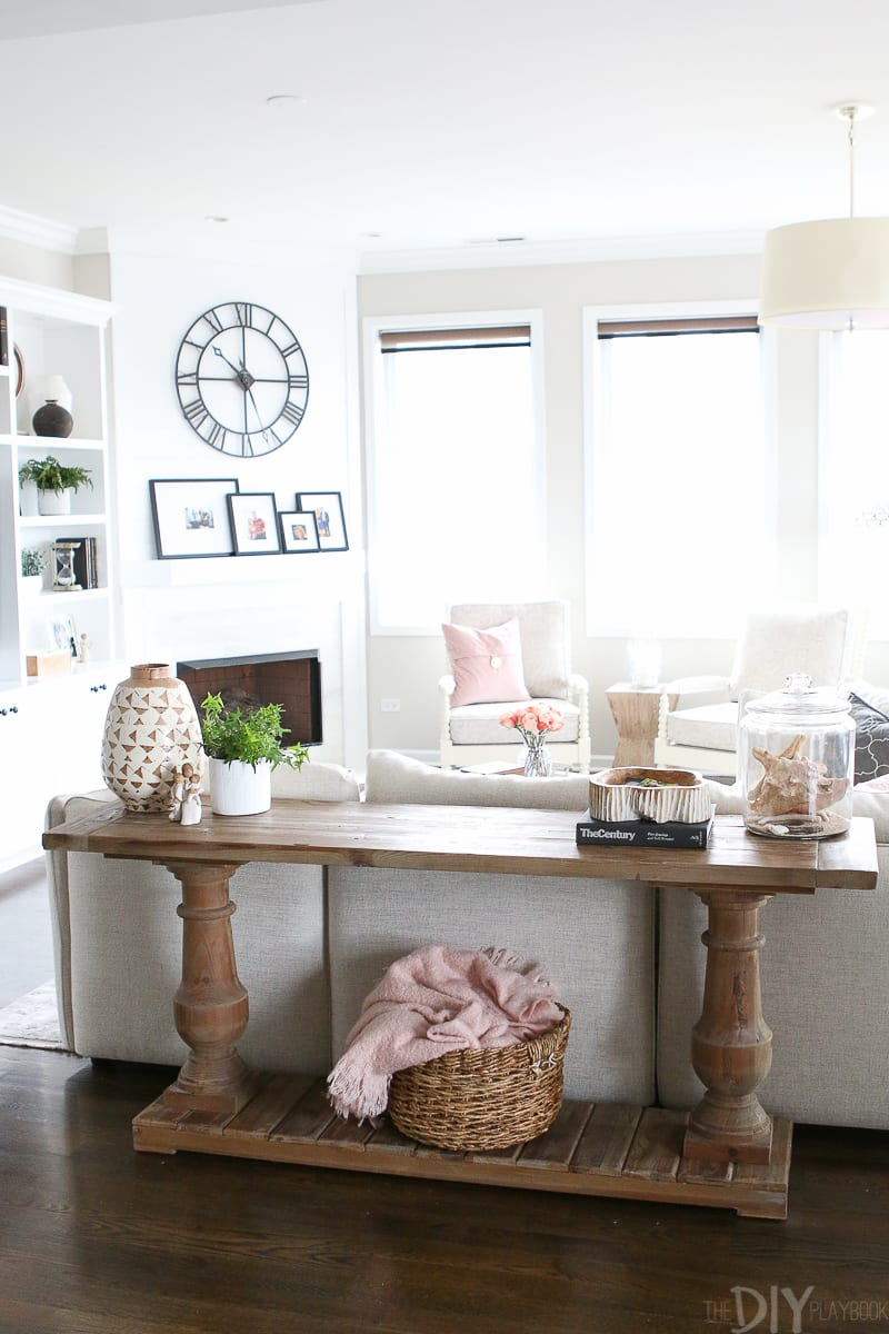 Console table behind a couch