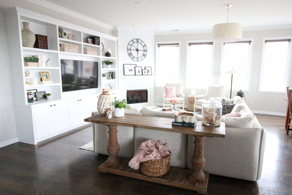 white built-ins and neutral sectional in family room