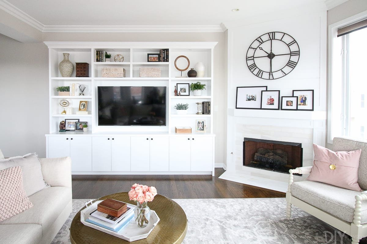 White built-ins and a white fireplace makeover
