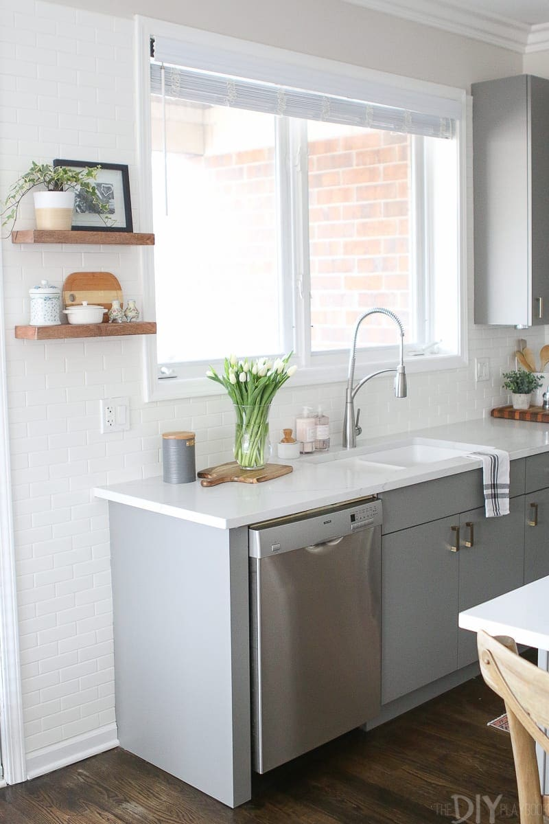 Gray Kitchen With Br Hardware
