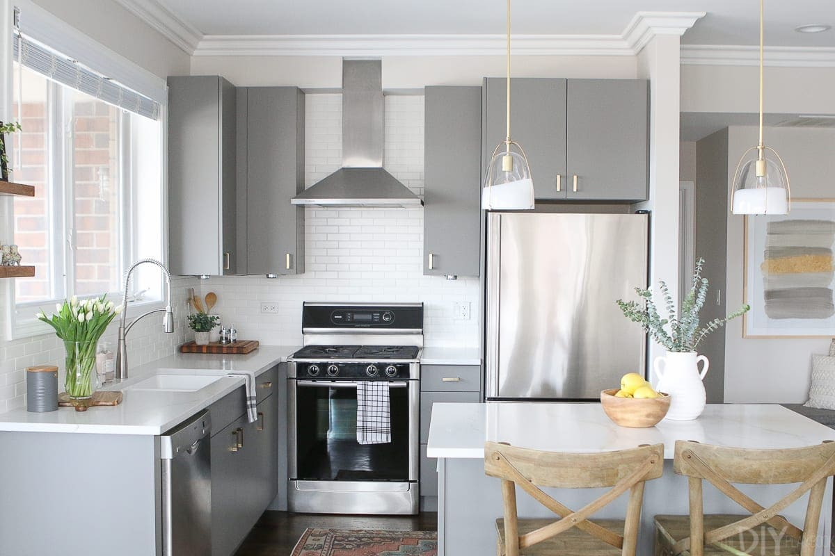 Brass accessories and hardware warm up this kitchen space.