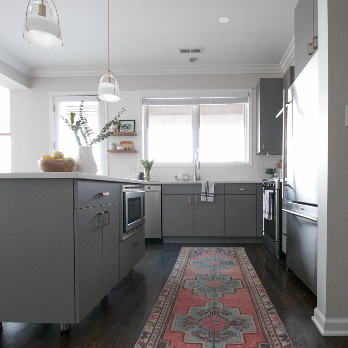 White Kitchen Cabinets With Gray Countertops: White + Gray Kitchen With Brass Hardware