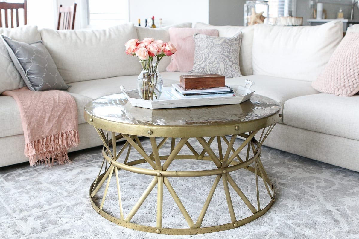 Love this round and gold coffee table with a large sectional