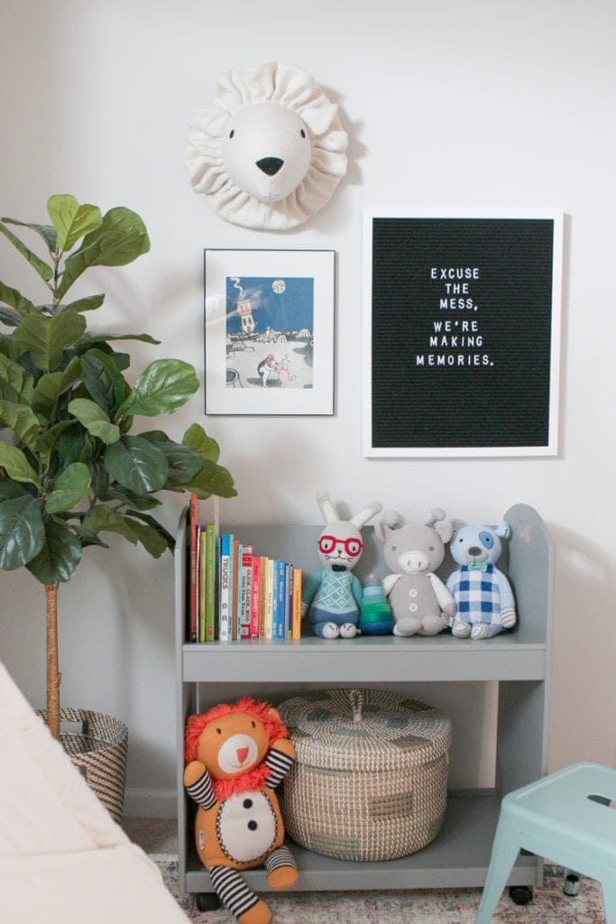 Use a rolling bookshelf to create an organized playroom