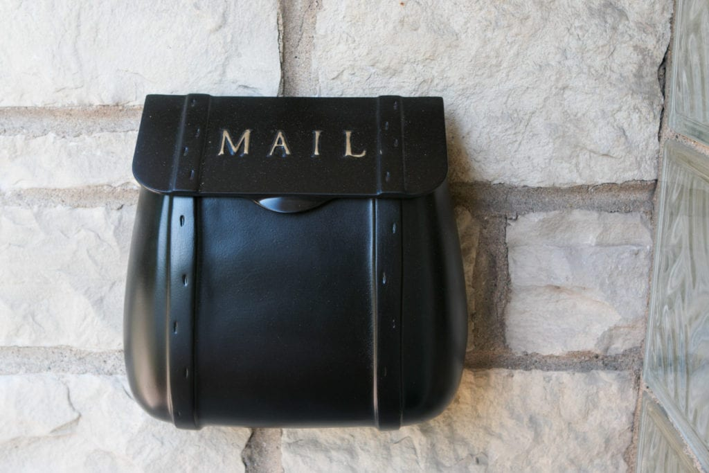 black mailbox with spray paint