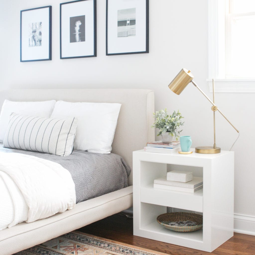 white nightstands with brass table lamp