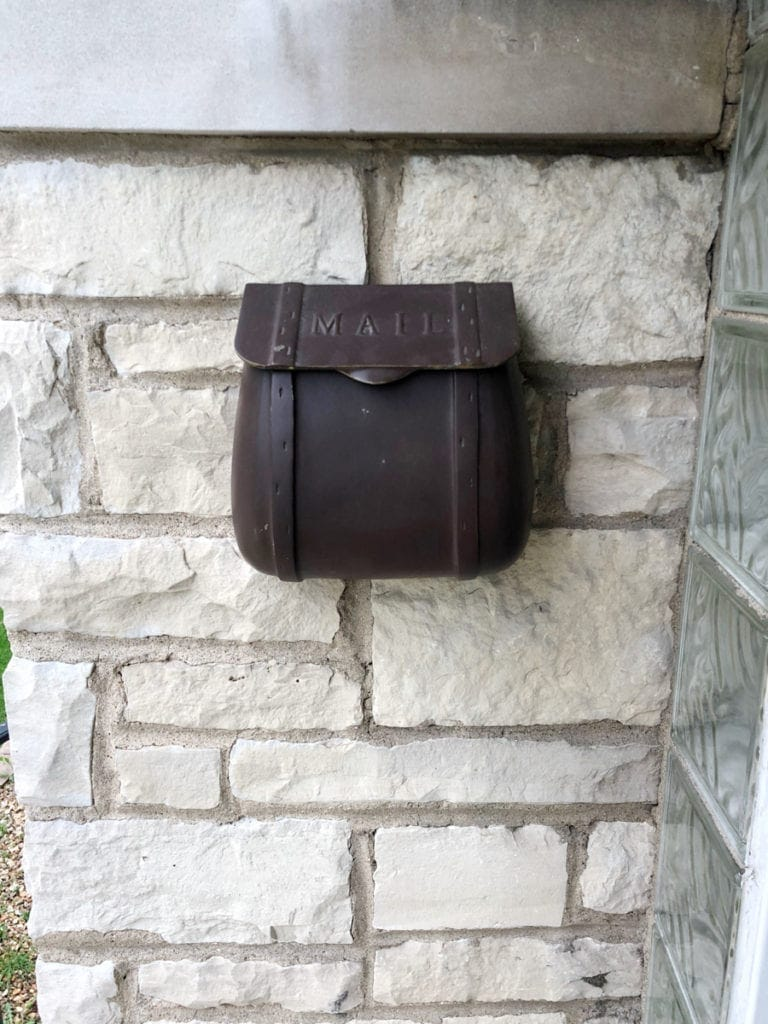 old brown mailbox before paint