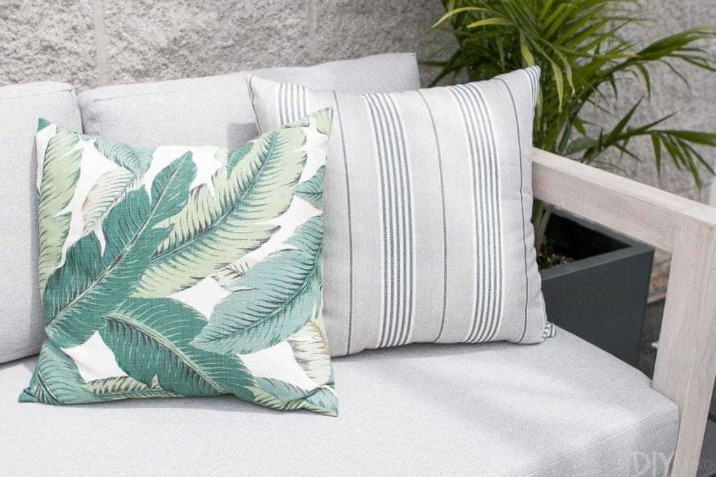 Outdoor pillows with palm print and stripes