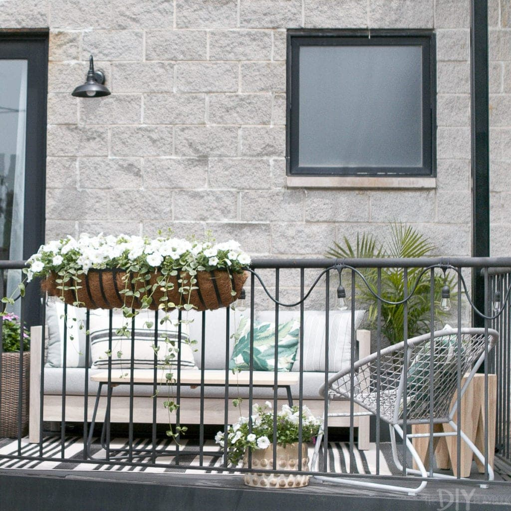 A small city balcony turned into an outdoor room