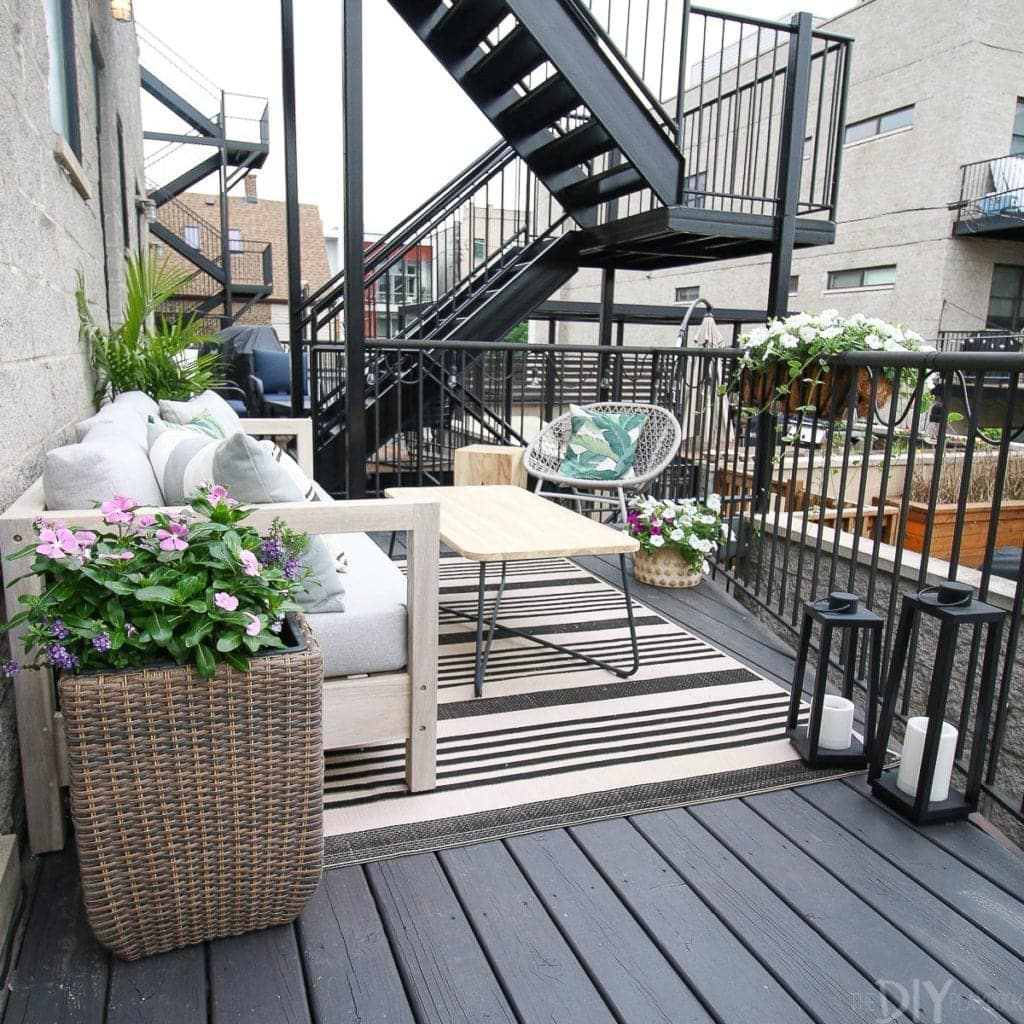 Small city patio with couch and coffee table