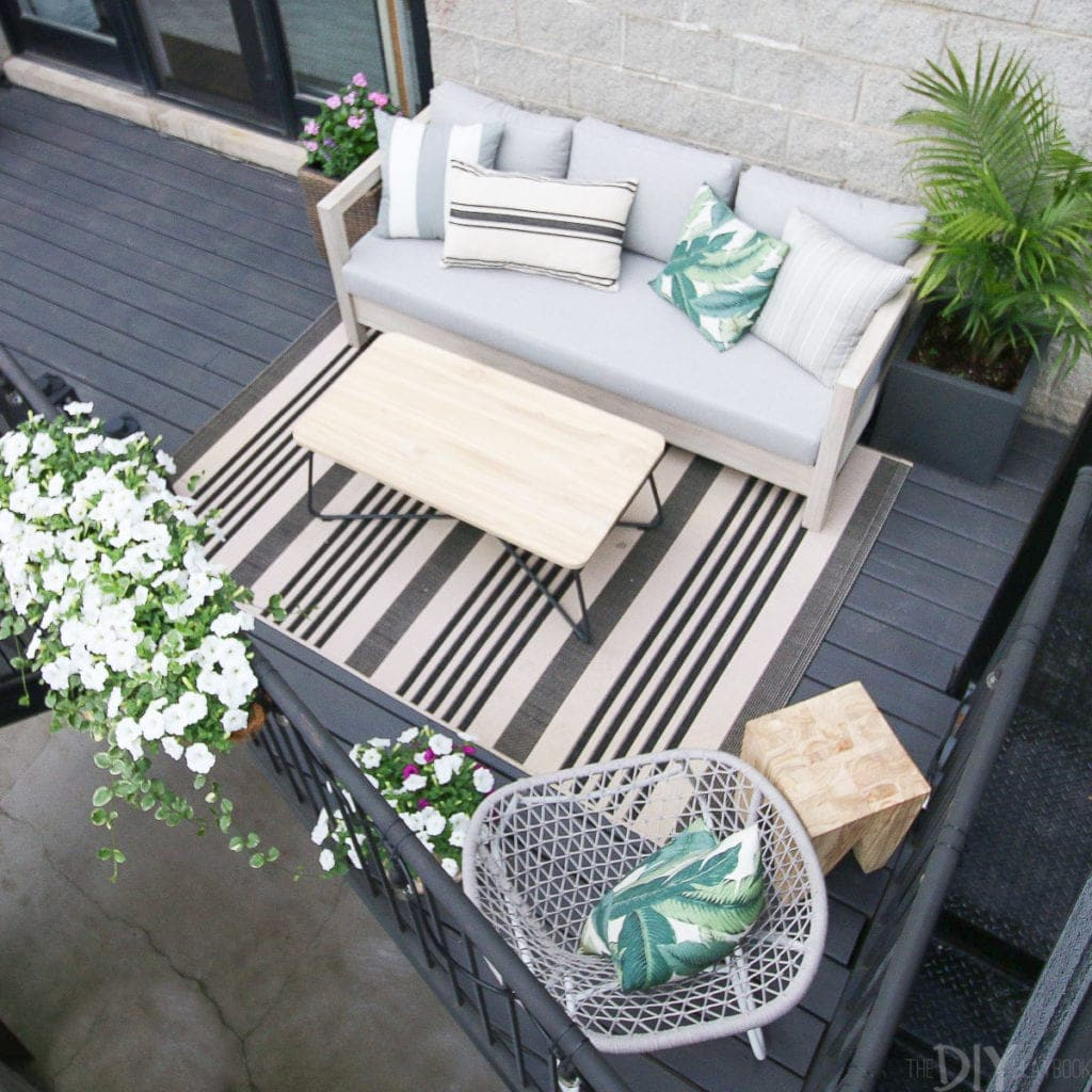 Make the most of your outdoor patio space with a couch, chairs, and coffee table