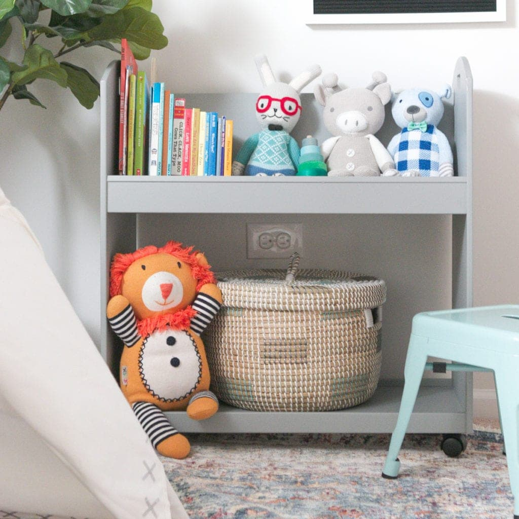 Put a small basket on the bottom of a bookshelf for hidden storage