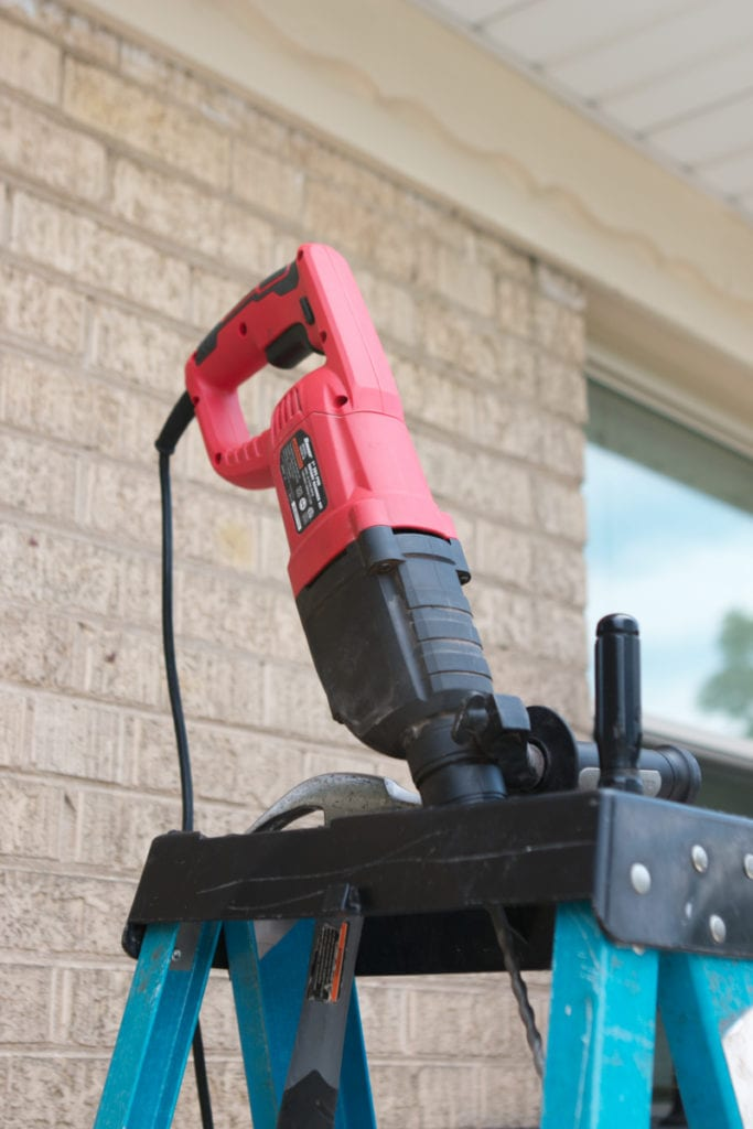 using a hammer drill to increase curb appeal