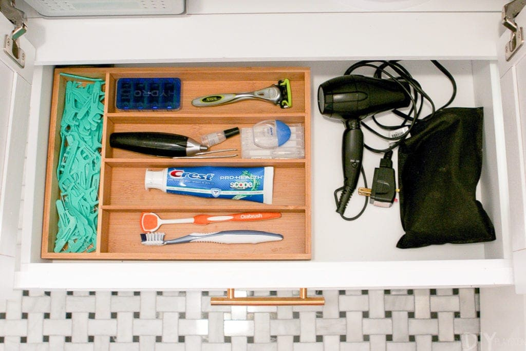 Use a silverware drawer tray to corral small bathroom items.