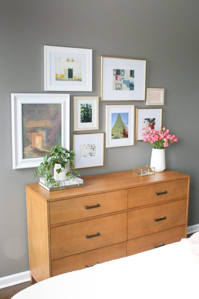 Asymmetrical gallery walls look good with a variety of prints and frame sizes