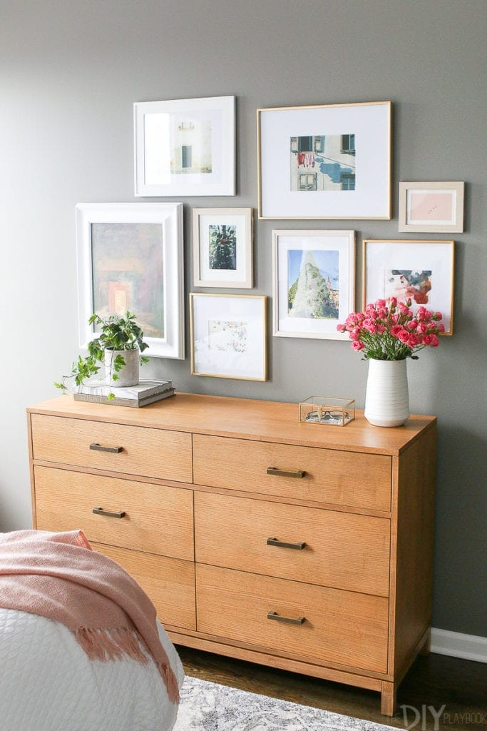 Gallery wall over a dresser