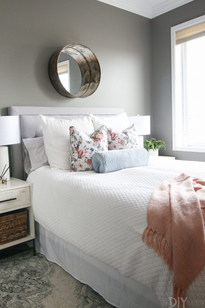 Gray guest bedroom with blush accents