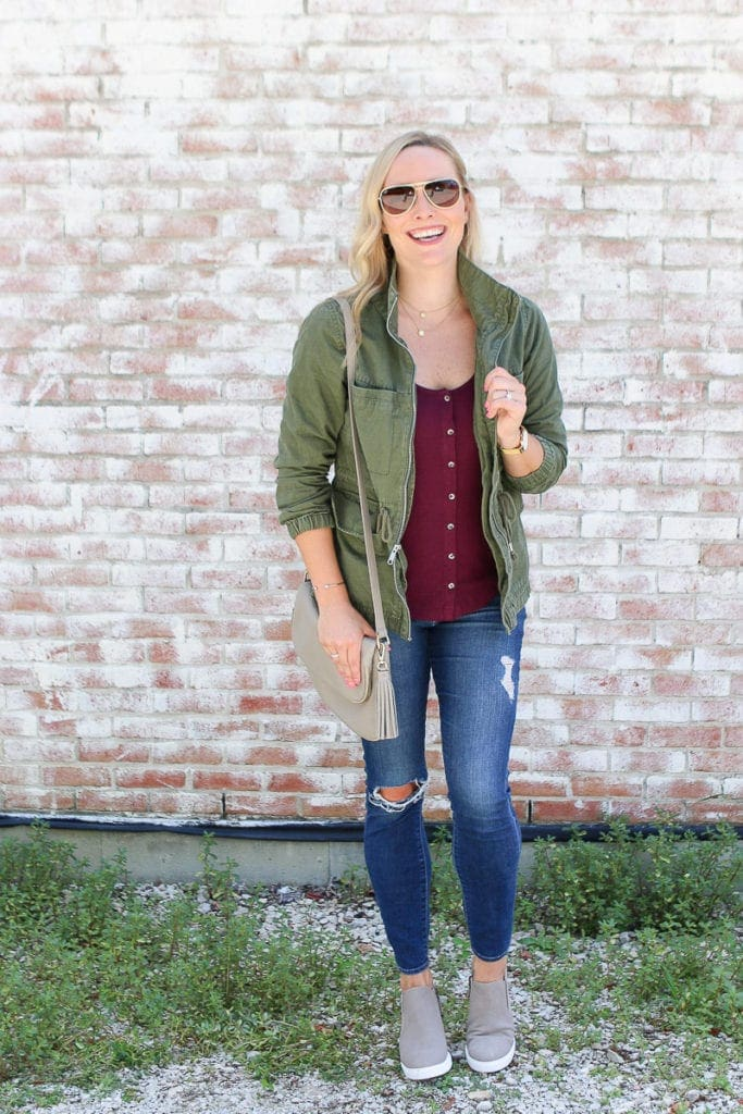 Layer a jacket over a blouse for a cozy fall look