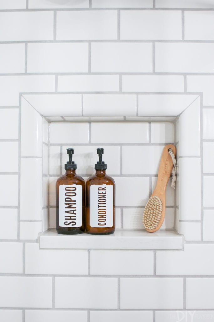 Use pretty glass bottles in a visible shower niche