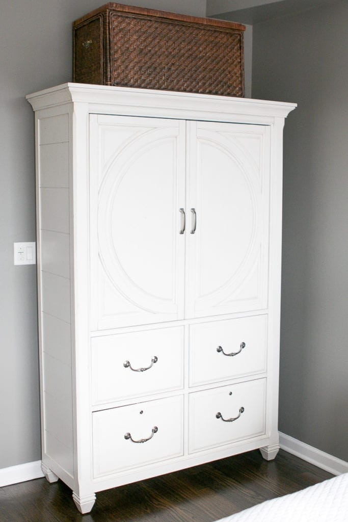 This large white cabinet from HomeGoods stores lots of office supplies