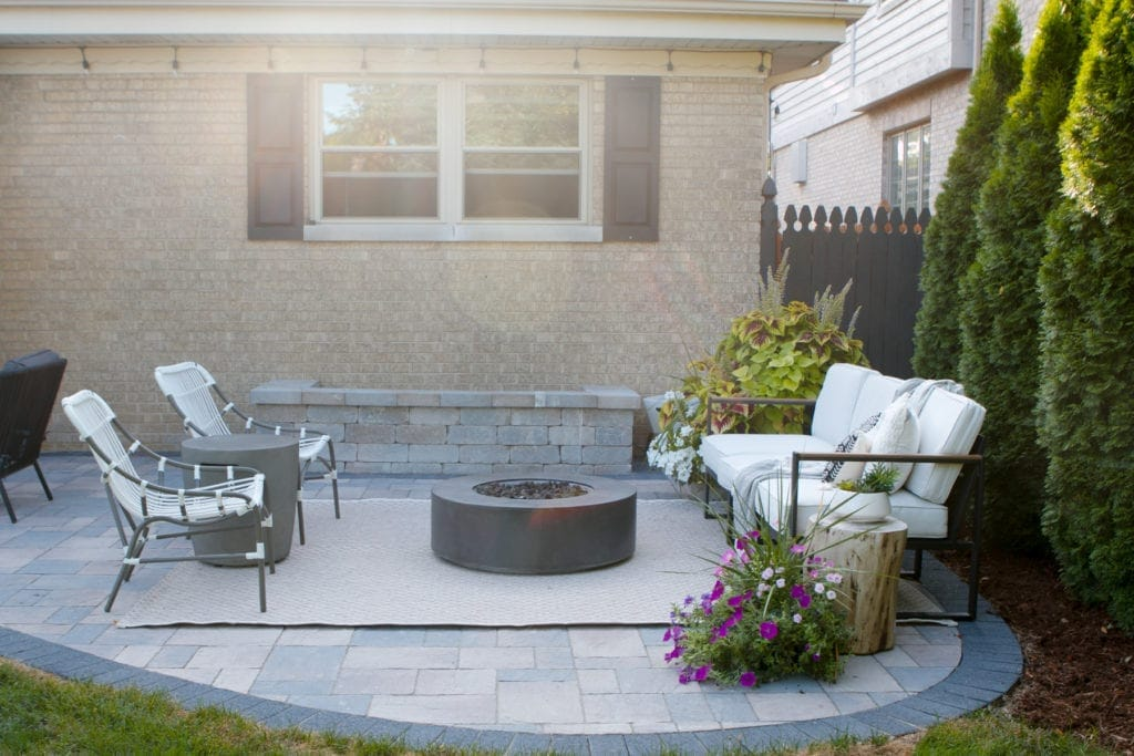 patio transformation with firepit and flowers