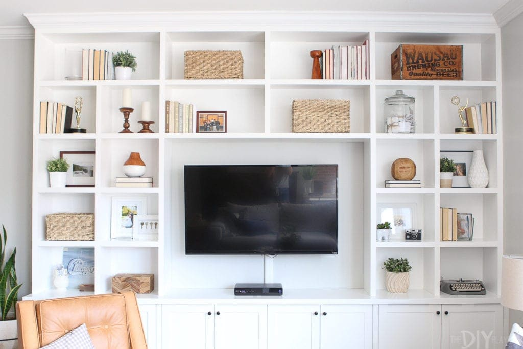 White built-ins filled with wicker baskets for storage