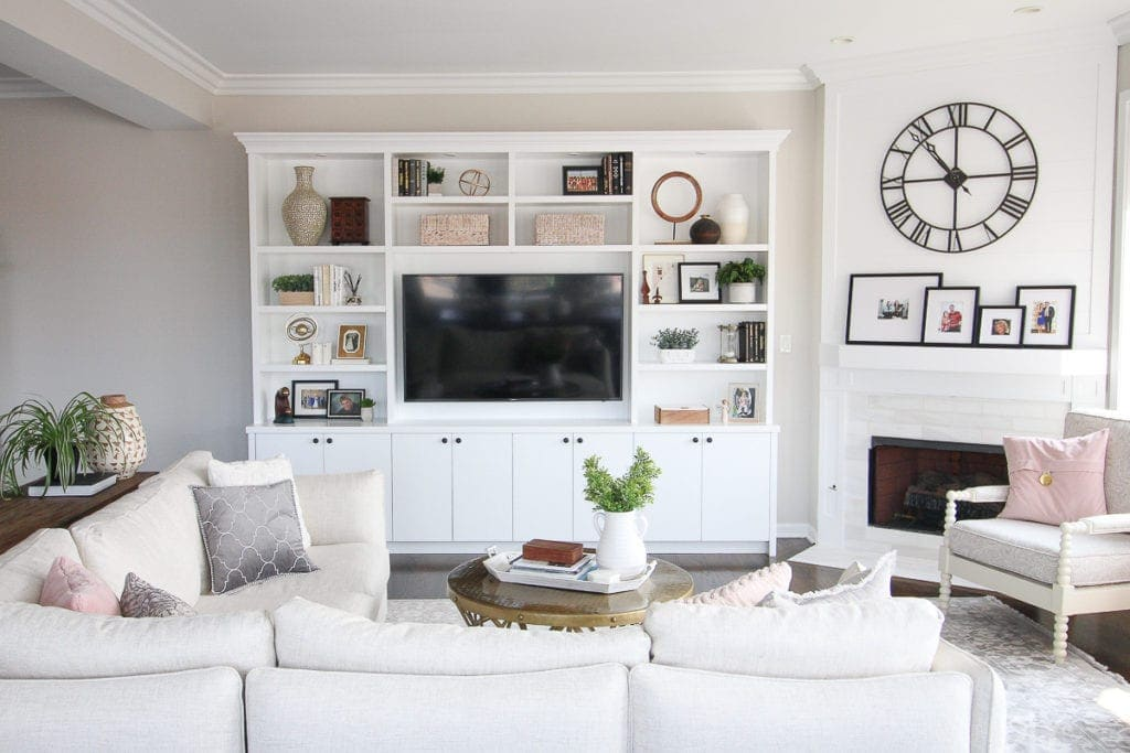 White built-ins in a family room with accessories