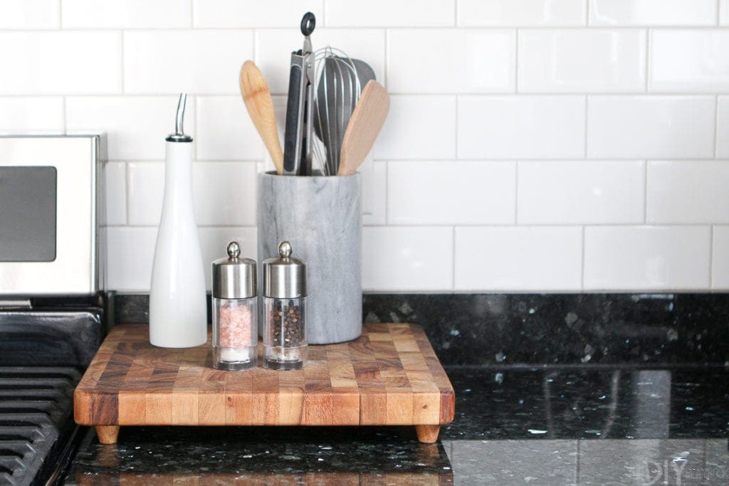 Use a cutting board to corral items