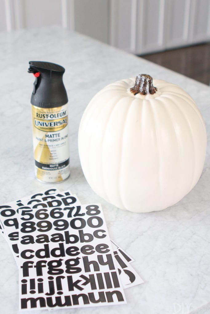 Supplies to paint a quote onto a pumpkin