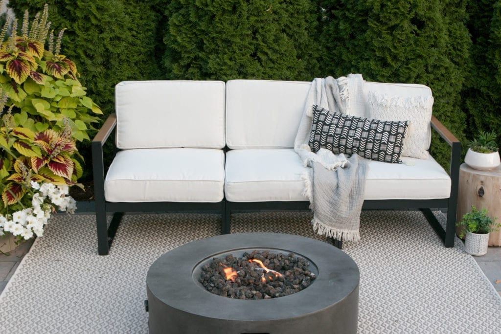 white patio couch in a patio reveal